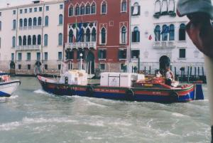 The delivery boat chugs along the canals
