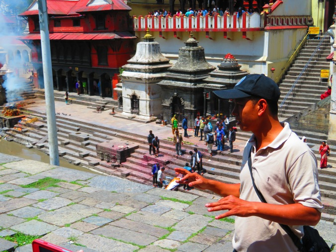 Our fabulous guide Nabin, explains the funeral proceedings at the Kathmandu sacred cremation site.