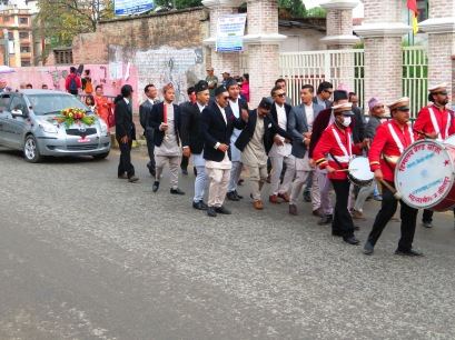 Here come's the Bride...and the Band. A Nepalese wedding dances down the street