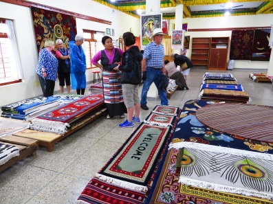 Carpet shopping at the Tibetan Refugee Camp Pokhara Nepal