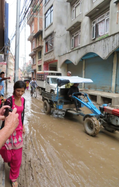 Navigating the muddy streets of Patan.