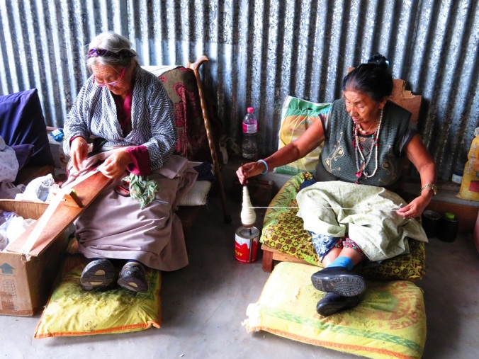 Tibetan refugees spin and weave