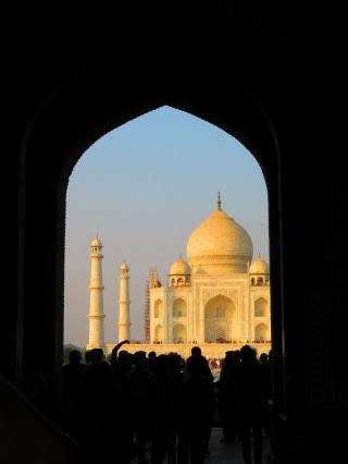 Doorway framing a scene of the Taj Mahal, India