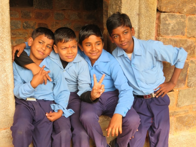 Young boys pose for a selfie. Delhi India