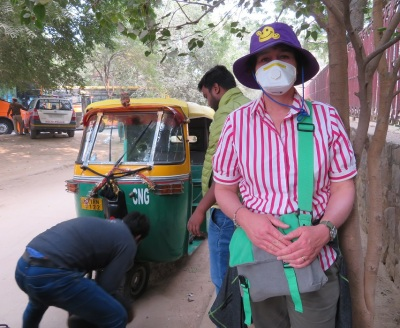 Wearing a face mask in Delhi while waiting for a tyre to be changed