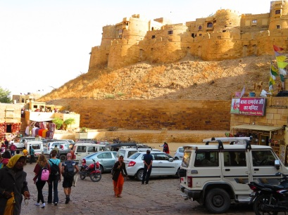 People walking in the carpark at the foot of the Jaisalmer Fort, Rajasthan India