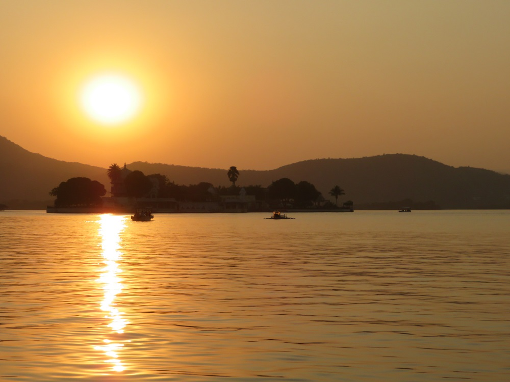 Sunset over Udaipur Lake showing an island