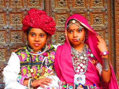 A young girl and young boy in traditional Indian dress.