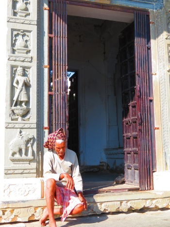 An old man waits at the door of temple, Udaipur.