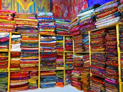 Shelves full of colourful textiles