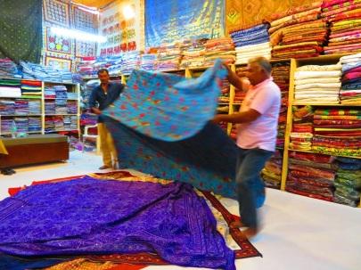 Two men show textiles