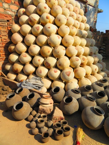 A tall stack of pottery water urns