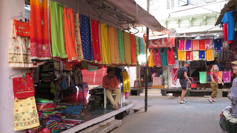 colourful shawls at a market stall