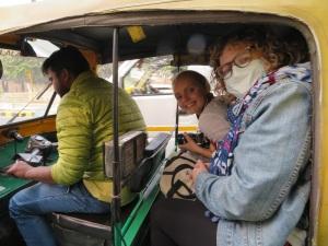 Tuk tuk and passengers
