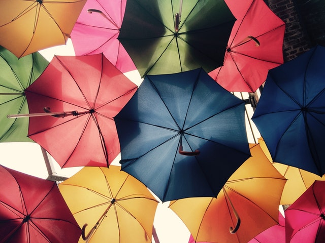 the Undersides of colourful umbrellas