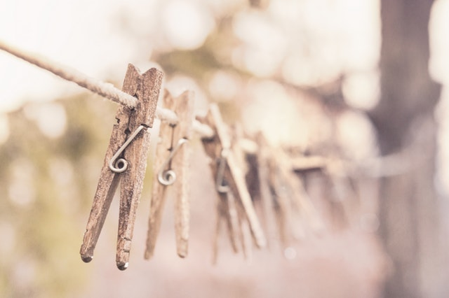 Sepia clothes pegs on a line
