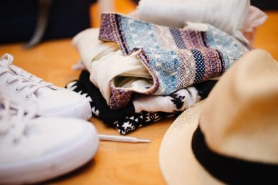 sun hat white sneakers and colourful clothes