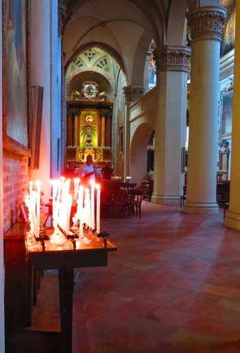 Lit candles in an Italian church