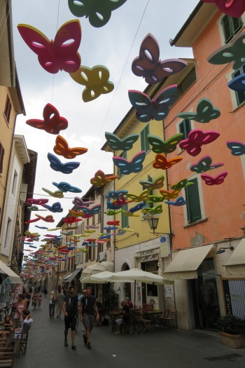 Colourful butterflies suspended over the main street in Pietrasanta