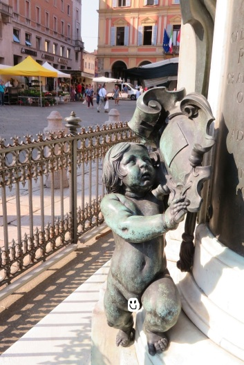 Bronze cupid sculpture in Piacenza