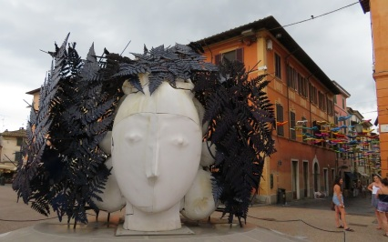 Large metal head sculpture