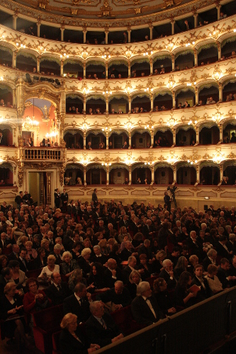 Internal view of Teatro municipale Piacenza at night with audience