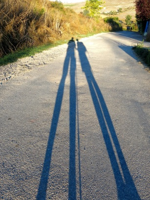 The shadows or silhouettes of two people walking the camino Frances