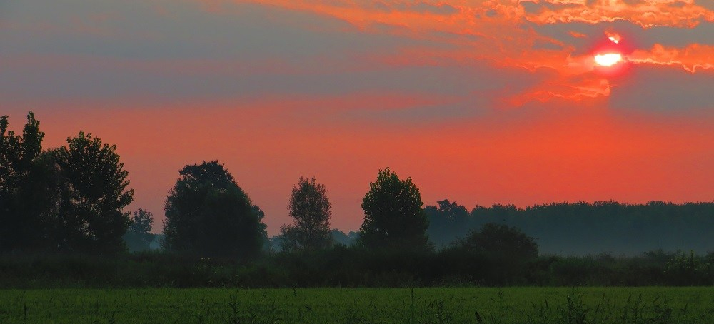 A burning red sunrise on the Italian via Francigena