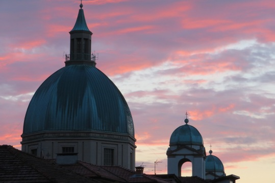 Sunrise behind a cathedral dome, Lucca Italy