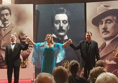 three opera singers with a Puccini backdrop
