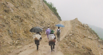 Four people Hiking in Sapa in the rain and mud