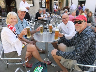People drinking beer and Celebrating the final steps into Santiago de Compostela