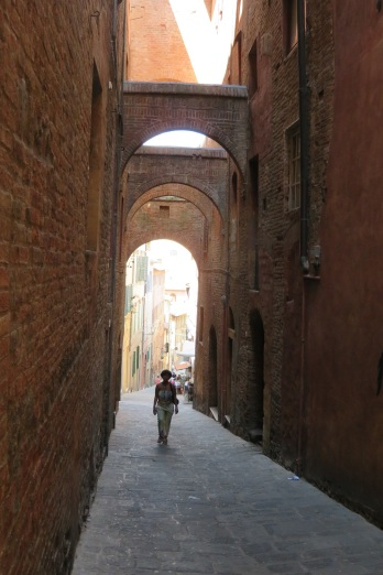 An arched alley way in Siena Italy