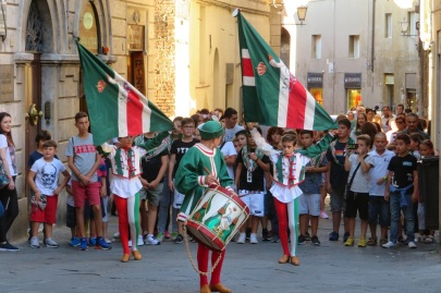 A parade of young people with flags and drums in Italy