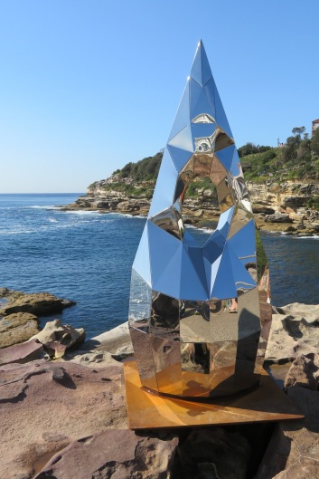A shiny pointed sculpture with the sea in the background, Sculpture by the Sea