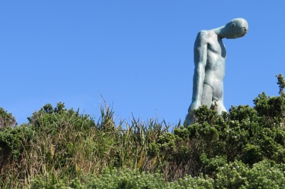 A very tall bronze sculpture of a naked man, Sculpture by the Sea