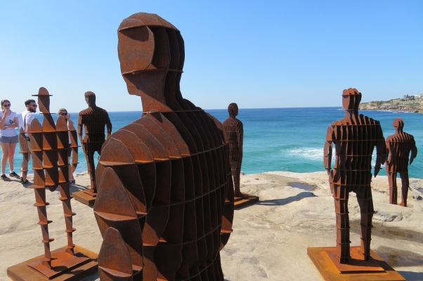 Metal cut outs of people standing on a cliff, Sculpture by the Sea