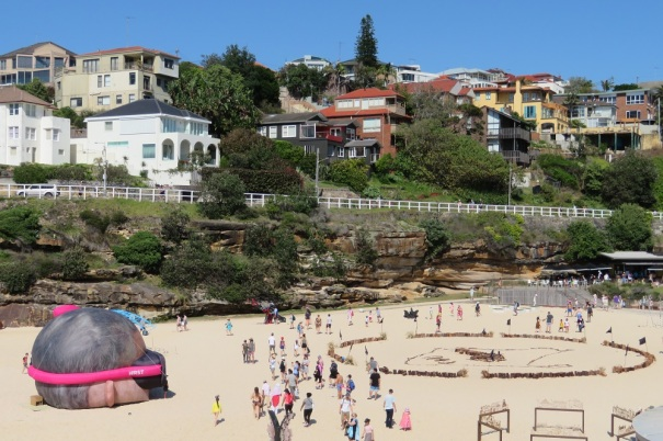 Installation works on the sand at Tamarama Beach, Sculpture by the Sea