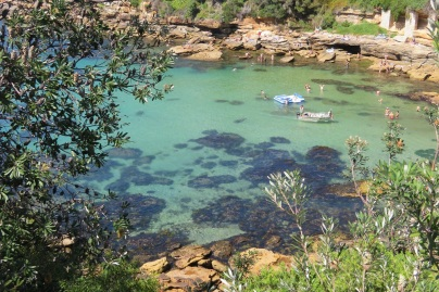 The crystal clear waters of Gordon's Bay with swimmers and boaters