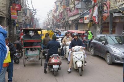 A busy street scene in Delhi