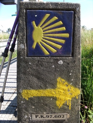 A yellow arrow marker on the Camino Portuguese