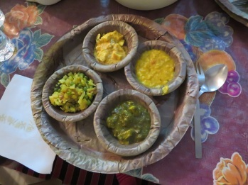 Plates and bowls made from leaves with delicious Indian food