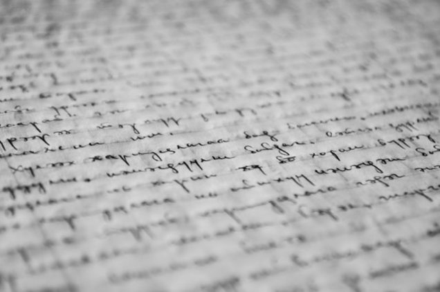 hand written words in black ink on a parchment page