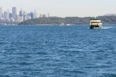 A Sydney ferry heads into Watsons Bay with the Harbour Bridge in the background