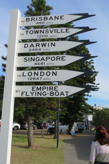 A sign showing directions to major cities by flying boat