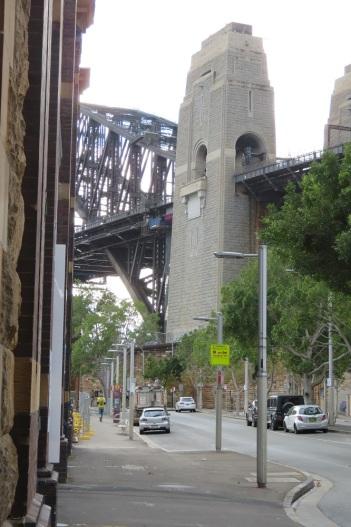 Sydney Harbour Bridge under grey skies - through the streets of Walsh Bay