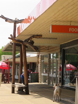 Carved verandah poles and seats in Walcha