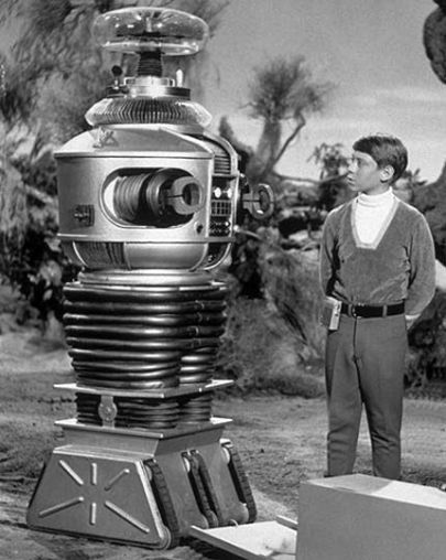 Lost in Space Image featuring the robot and Will Robinson