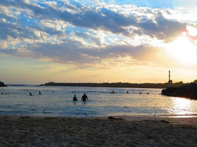 People swimming in the early morning at Tuncurry Rock Pool