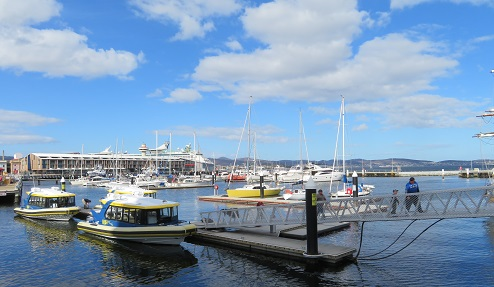 Boats at Constitution Dock in Hobart on a blue sky day